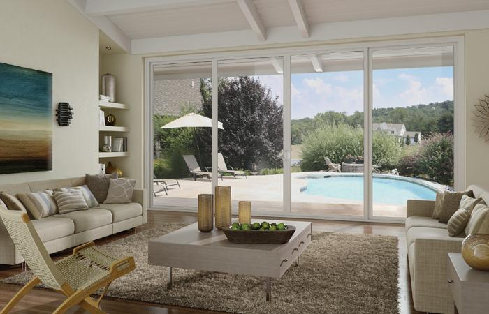 milgard sliding glass patio doors in living room looking out over backyard with pool