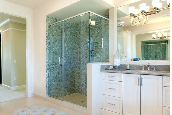 glass shower enclosure with blue tile