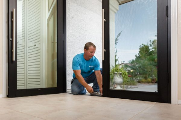 true view employee installing glass entry doors