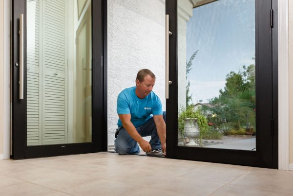 true view employee installing glass entry doors