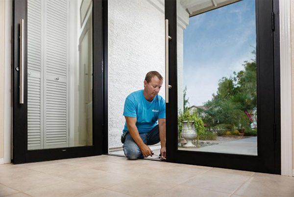 true view employee making door repair
